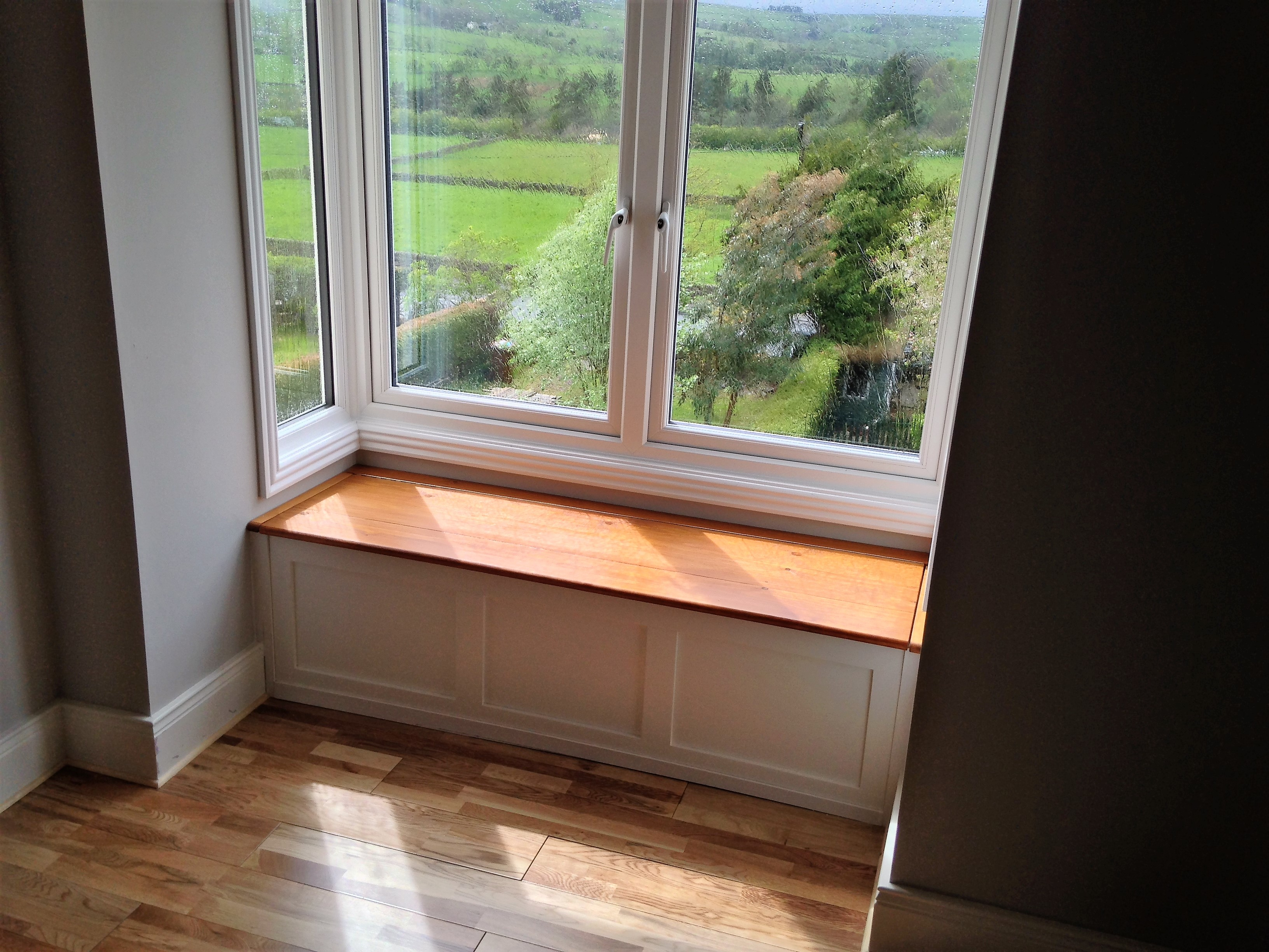 A beautiful bay window seat to complete the picturesque view.